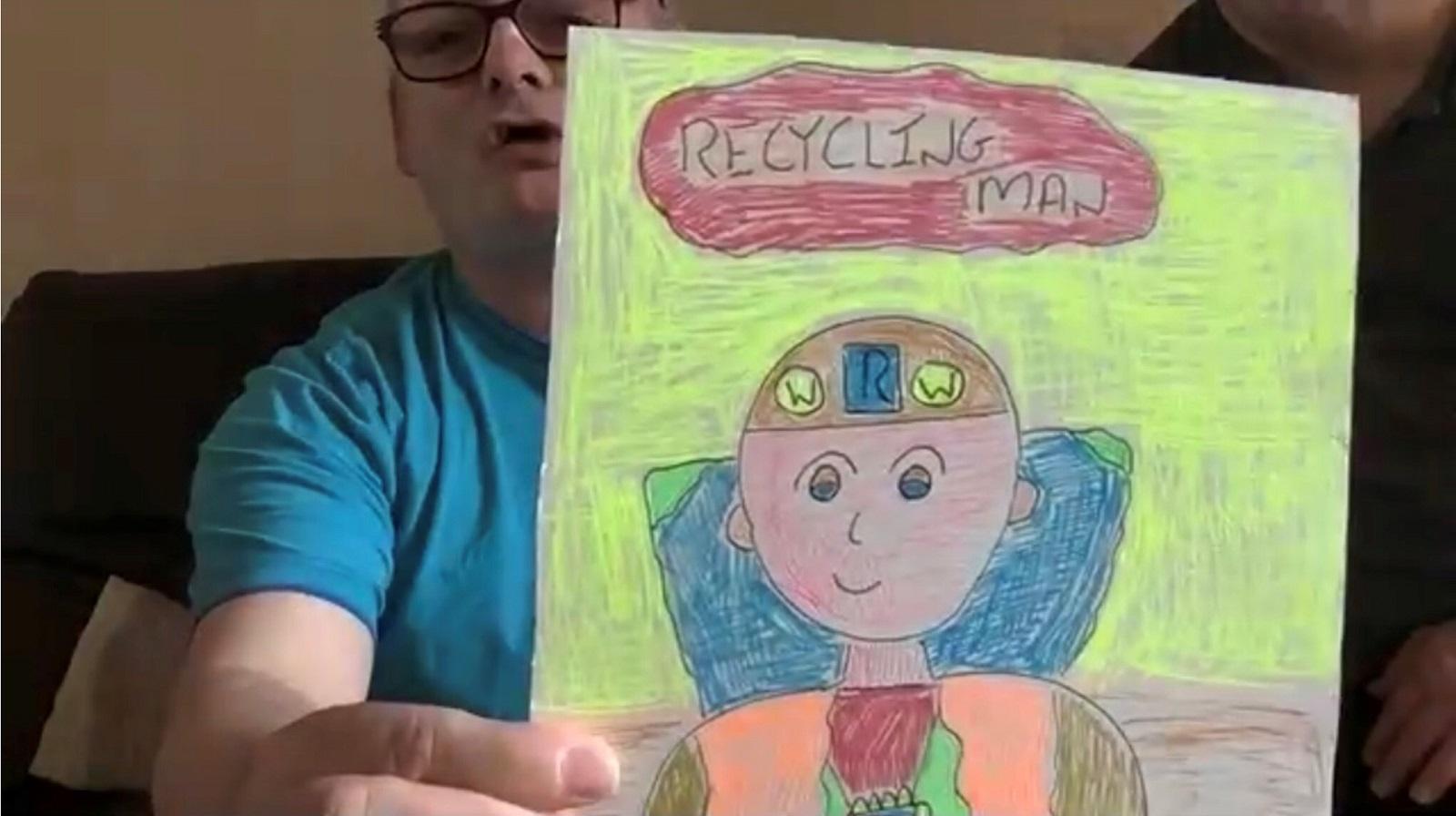Eric Logan and his new environmentally-friendly superhero, Recycling Man.